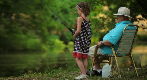 Grandaughter and Grandad fishing nearby AFRH